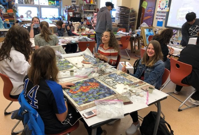 Waterford High School students working on their mosaics. These will be attached to pavers that will create the walking paths of the labyrinth.