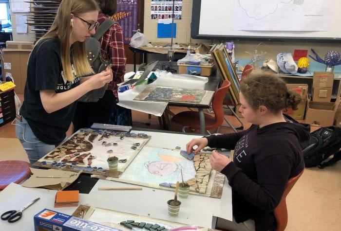 Two students working on their mosaics