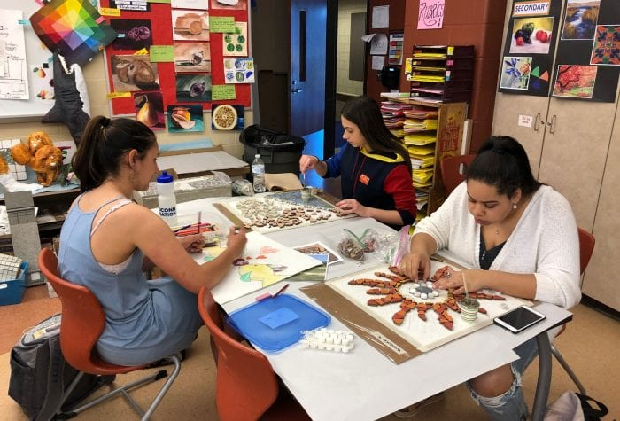 Students working on their mosaics
