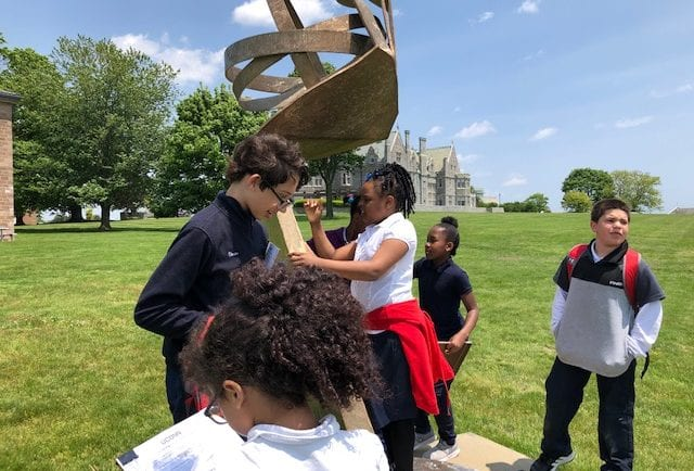 Students enjoy interacting with art on a scavenger hunt