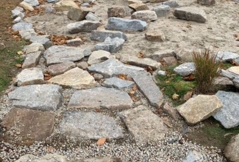 The stone walkway from sidewalk to sandpit